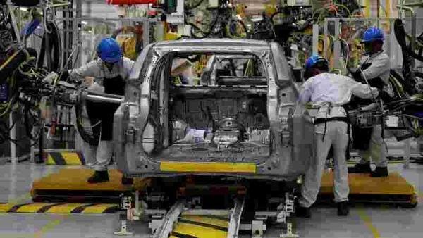 File photo of workers assembling a Mitsubishi Pajero at a Mitsubishi car factory. (REUTERS)
