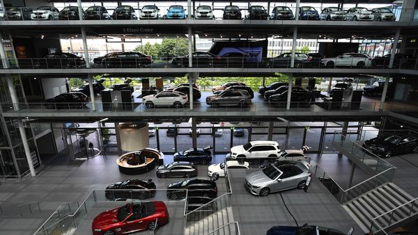 A range of Mercedes-Benz luxury automobiles, manufactured by Daimler AG, sit on display in the automaker's showroom in Munich. (File photo) (Bloomberg)