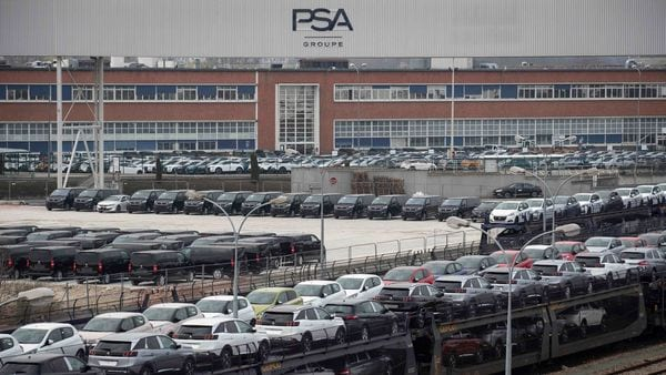 File photo: Cars are parked in a lot in front of a plant of French automaker PSA Peugeot-Citroen, at Poissy, on the outskirts of Paris. (AFP)