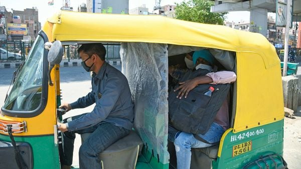 An auto rickshaw is seen with a plastic layer divider between passenger and driver side in New Delhi on Wednesday (May 19).