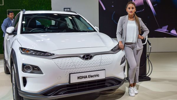 Greater Noida: A model poses next to a Hyundai Kona Electric car displayed at the Auto Expo 2020 in Greater Noida, Wednesday, Feb. 5, 2020. (PTI Photo/Ravi Choudhary) (PTI)