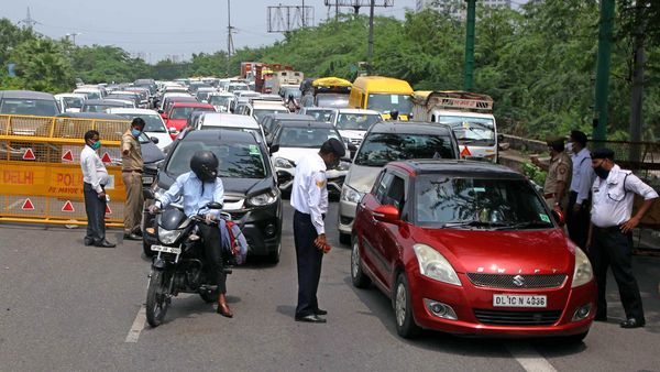 UP Police checking curfew pass for the entry in Uttar Pradesh at Delhi Noida border during the weekend lockdown in Noida.