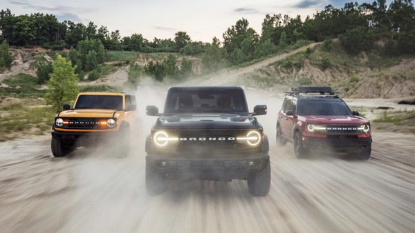 Pre-production versions of the all-new 2021 Bronco family of all-4x4 rugged SUVs, include (left) Bronco two-door in Cyber Orange Metallic Tri-Coat, Bronco four-door in Shadow Black and Bronco Sport in Rapid Red Metallic Tinted Clearcoat.