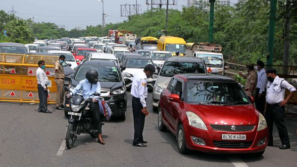 UP Police checking curfew pass for the entry in Uttar Pardesh at Delhi UP Border during the weekend lockdown, in Noida on Saturday. (ANI Photo)