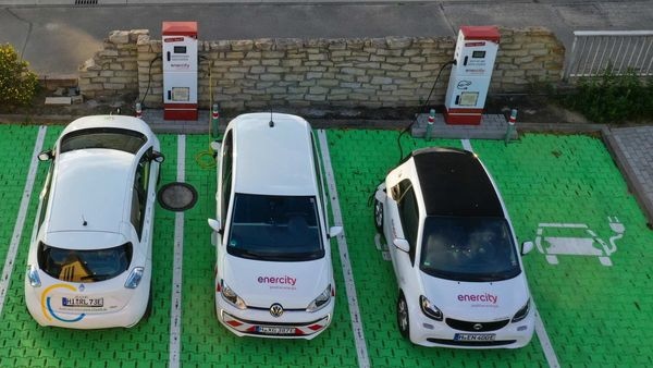 Electric vehicles sit parked in bays as they charge at an electric vehicle charging site in Germany. (Bloomberg)