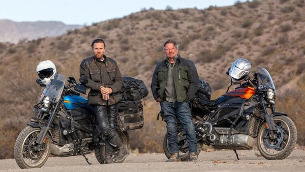 Ewan McGregor and Charley Boorman pose with Harley-Davidson electric bikes LiveWire during the production of a new motorcycle adventure series Long Way Up. (Photo courtesy: Apple)