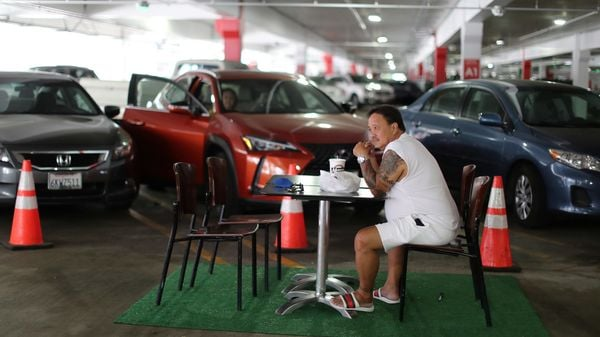 Renato Pinera eats lunch in a dining area set up in the Glendale Galleria mall parking garage, as the global outbreak of the coronavirus disease continues, in Glendale, California, US. (REUTERS)