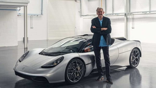 Gordon Murray poses with the T.50 hypercar.