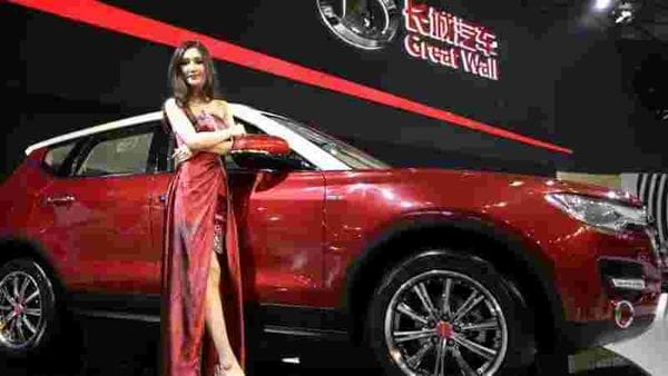 A model poses with Great Wall H7 SUV at the Shanghai International Automobile Industry Exhibition. (File photo)