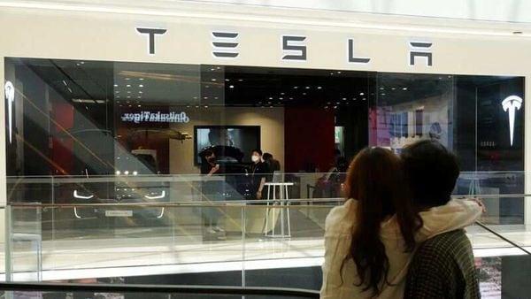 File photo - A couple looks at a Tesla dealership in Hanam, South Korea. (REUTERS)