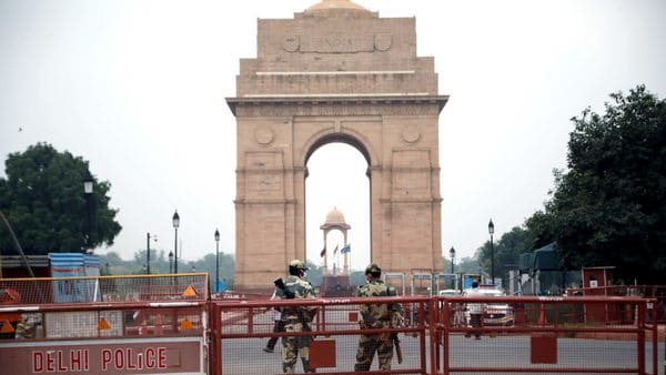 Police personnel stand guard outside India Gate ahead of Independence Day celebrations, in New Delhi.