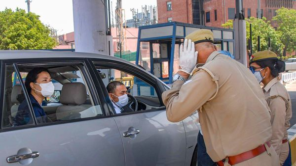 Police personnel check a commuter travelling from Delhi to Noida. (File photo used for representational purpose only) (PTI)