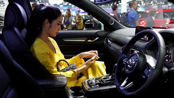 File photo - A customer sits in a Mazda CX-8 during the media day of the 41st Bangkok International Motor Show. Mazda will make crossover vehicles at its new plant in Alabama where it will share space with Toyota. (Image used for representational purpose) (REUTERS)