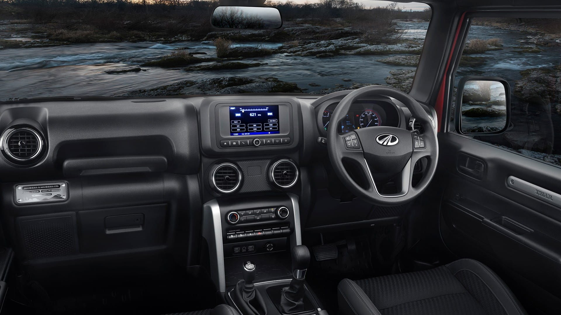 The seven-inch infotainment screen inside the new Thar supports Android Auto and Apple CarPlay and is claimed to be drizzle proof.