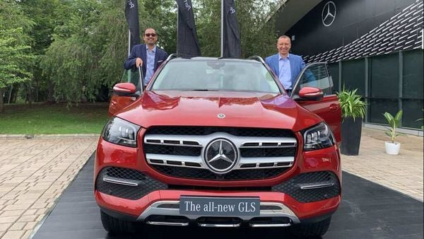 Mercedes India MD Martin Schwenk (right) posing with the newly launched 2020 GLS SUV in India,