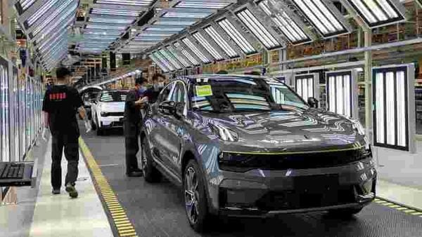 File photo - Employees wearing face masks following the coronavirus disease (COVID-19) outbreak work on a Lynk & Co car production line at Geely's Yuyao plant in Ningbo city. (REUTERS)