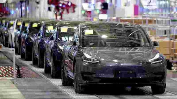 FILE PHOTO: Tesla China-made Model 3 vehicles are seen during a delivery event at its factory in Shanghai. (REUTERS)