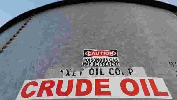 FILE PHOTO: A sticker reads crude oil on the side of a storage tank in the Permian Basin in Mentone, Loving County, Texas, US. (REUTERS)