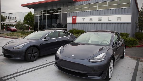 Tesla Inc. electric vehicles sit parked outside the company's factory in Fremont, California. (Bloomberg)