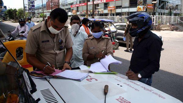 Police personnel fine a motorist in Noida. (File Photo)