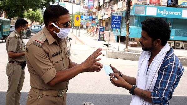 Police personnel interact with commuter in Noida. (File Photo)