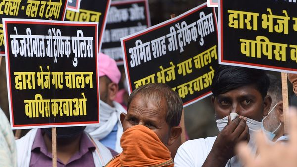 Ola, Uber drivers hold placards during a demonstration demanding fare hike and extension of moratorium on repayment of loans in New Delhi. (PTI)