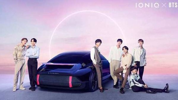 K-pop band BTS members pose with Hyundai Ioniq EV.