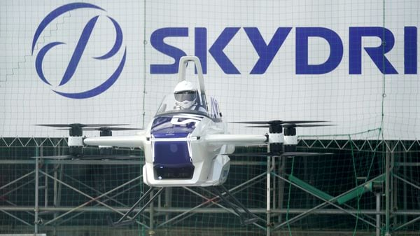 The SkyDrive Inc. SD-03 flying car is test-flown during a demonstration to the media at the Toyota Test Field in Toyota City. (Bloomberg)
