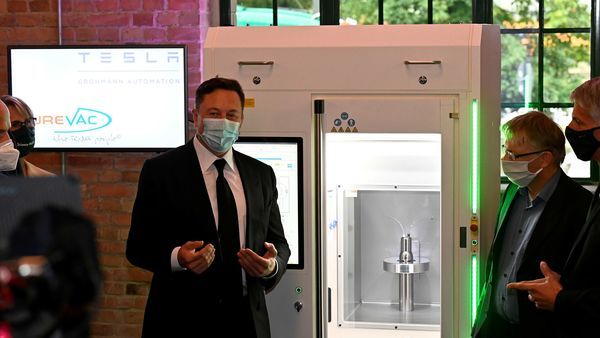 Elon Musk presents an RNA printer, essentially a vaccine production device, on the sidelines of a meeting with the leadership of the conservative CDU/CSU parliamentary group in Berlin. (REUTERS)