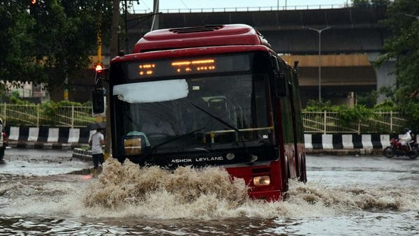 File photo - DTC bus makes his way through a flooded street during heavy rainfall, in New Delhi.
