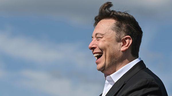 Technology entrepreneur Elon Musk laughs as he visits the Tesla Gigafactory construction site in Gruenheide near Berlin. (AP)