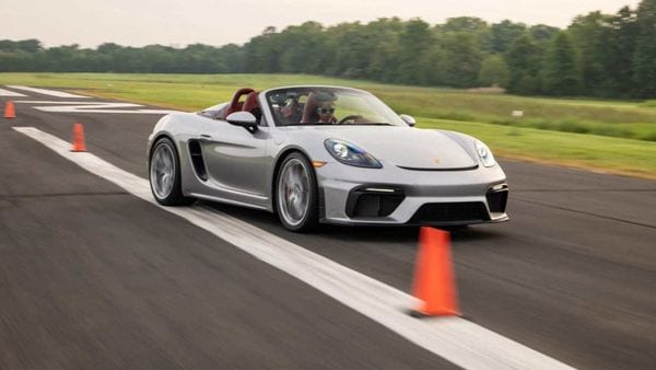 Chloe Chambers using speed and skill to push a Porsche 718 Spyder into Guinness World Records.