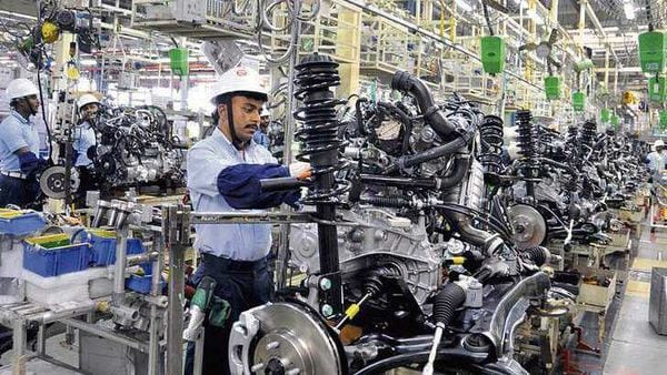 A Toyota employee at work at the carmaker's Maharashtra unit. (MINT_PRINT)