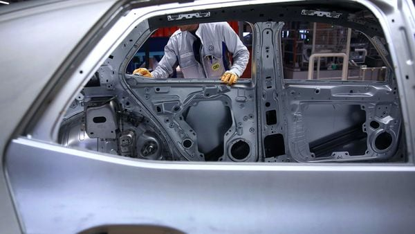An employee carries out quality checks on a chassis on the assembly line in the Volkswagen AG (VW) ID.3 electric automobile factory in Zwickau, Germany. (File photo used for representational purpose) (Bloomberg)