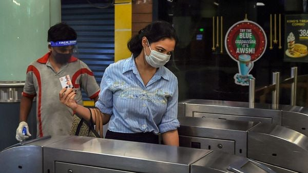 A commuter wearing face mask exits a station as Delhi Metro resumes operations in a graded manner. (PTI)