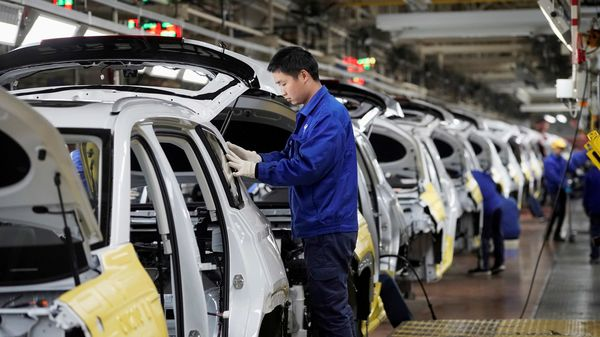 File photo - Employees work on Baojun RS-5 cars at a final assembly plant operated by General Motors Co. (Image used for representational purpose only). (REUTERS)