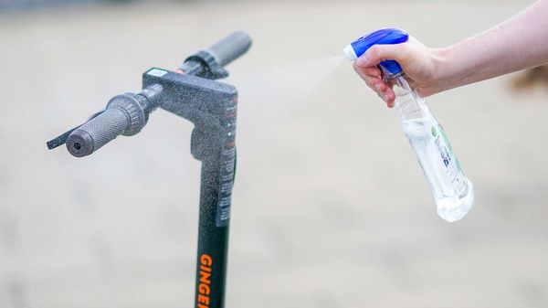 A volunteer sprays an e-scooter with disinfectant as a means to protect against coronavirus during a trial of rental e-scooters by Ginger Teleporter in Seaton Carew, Hartlepool, UK. (File photo for representational purpose) (Bloomberg)