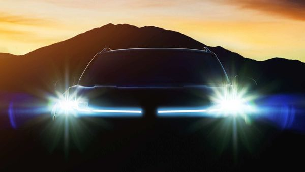 The teaser image of the new compact SUV from Volkswagen shows thin LED lights and the silhouette of the upper portion of the car.