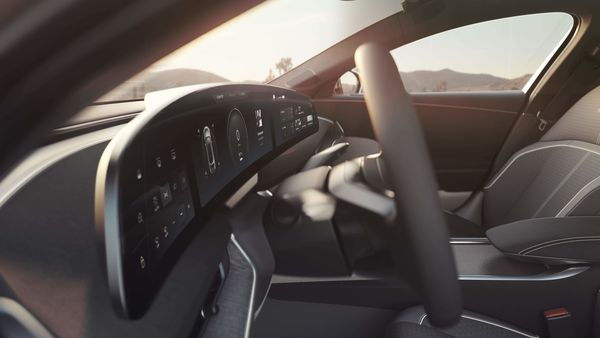In front of the driver seat, there is a 34-inch curved Glass Cockpit 5K display that floats above the dashboard, contributing to the light and airy feel of the interior