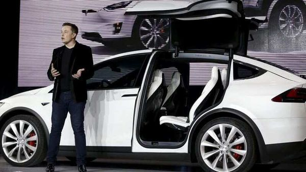 Tesla Motors CEO Elon Musk introduces the falcon wing door on the Model X electric sports-utility vehicles. (File Photo) (REUTERS)