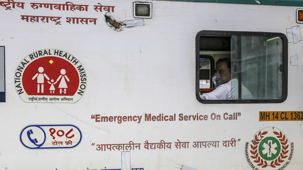 A man wearing an oxygen mask sits inside an ambulance in Boisar, Maharashtra. (File photo used for representational purpose) (Bloomberg)