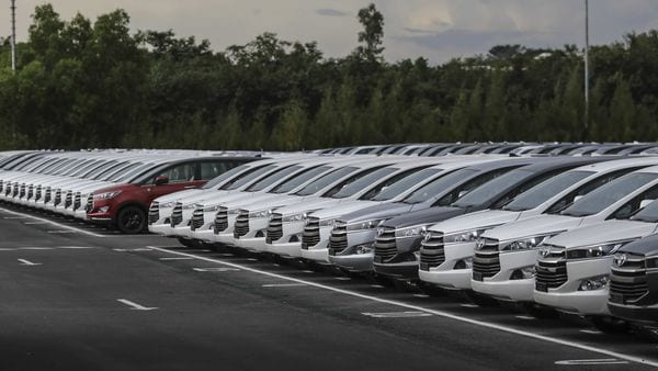 Toyota Motor Corp. Innova Crysta multi-purpose vehicles (MPV) sit in parking area at the Innova Crysta compact multi-purpose vehicle (MPV) production line at the Toyota Kirloskar Motor Ltd. plant in Bidadi, Karnataka, India, on Wednesday, Sept. 9, 2020. Toyota Motor Corp.�won't expand further in India due to the country's high tax regime, a blow for Prime Minister�Narendra Modi, who's trying to lure global companies to offset the deep economic malaise brought on by the coronavirus pandemic. Photographer: Dhiraj Singh/Bloomberg (Bloomberg)
