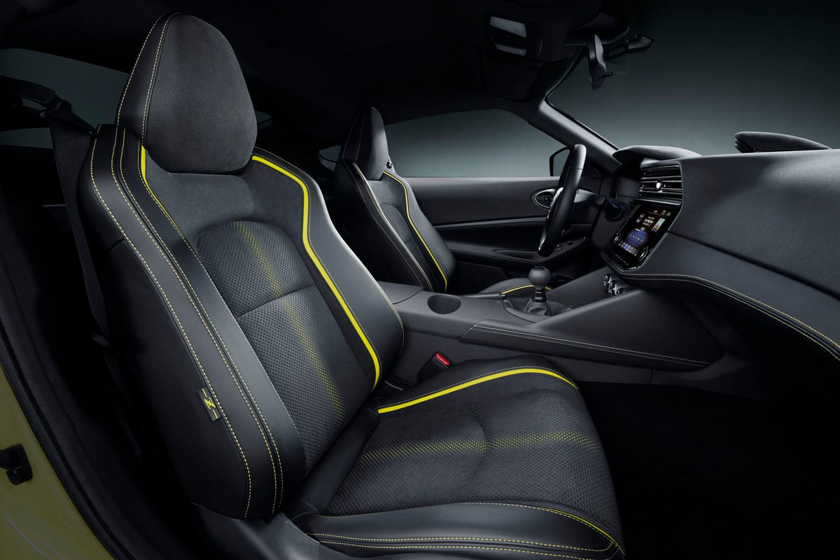 The Z Proto's cabin is every bit as modern as it can get with multiple screens for a wide variety of controls, a three-spoke steering wheel with control buttons, seats of Alcantara and leather with yellow stitching.