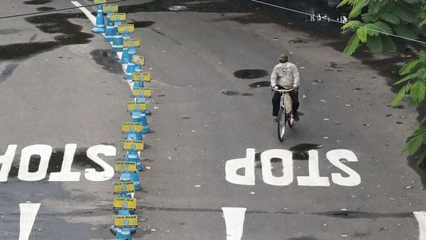 A man rides his bicycle on a deserted road in Kolkata. (File photo) (REUTERS)