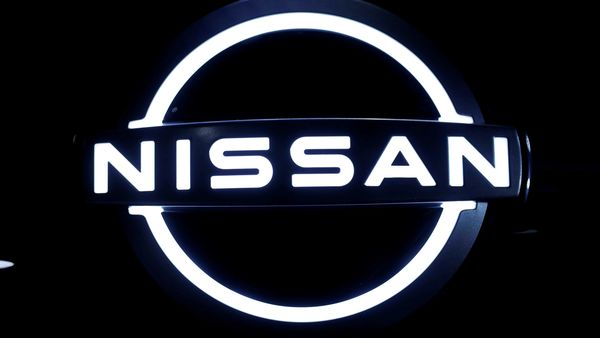 FILE PHOTO: The brand logo of Nissan Motor Corp. is seen at the front nose section of the company's new Ariya all-battery SUV during a press preview, ahead of the world premiere, at Nissan Pavilion in Yokohama, south of Tokyo, Japan July 14, 2020. REUTERS/Issei Kato/File Photo (REUTERS)