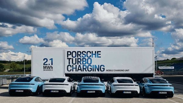 Photo of Porsche's high-power charging trucks offering charging infra for Taycan EV.