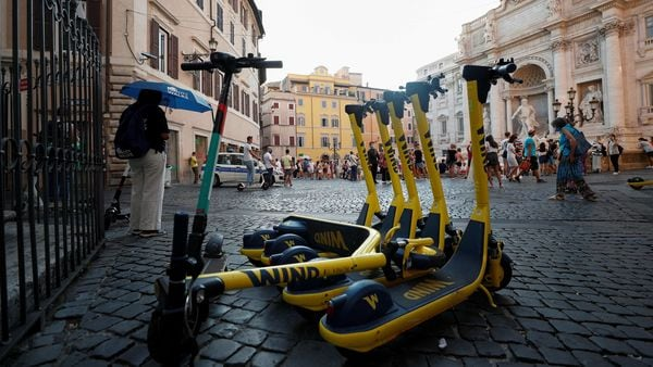 Electric scooters are parked near Trevi Fountain in Rome, Italy on September 18, 2020. (REUTERS)