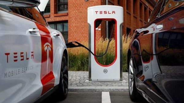 Tesla cars seen charging (REUTERS)
