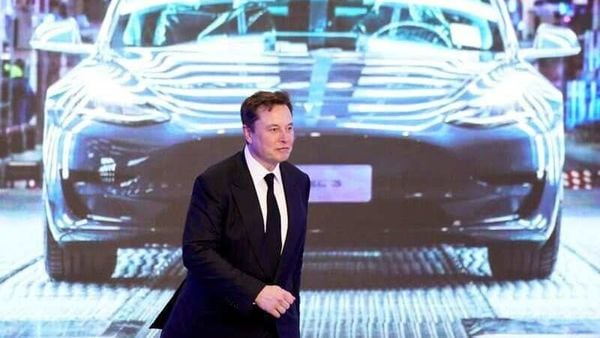 FILE PHOTO: Tesla Inc CEO Elon Musk walks next to a screen showing an image of Tesla Model 3 car during an opening ceremony for Tesla China-made Model Y program in Shanghai, China January 7, 2020. REUTERS/Aly Song/File Photo (REUTERS)