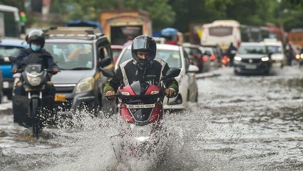 Vehicles move on a waterlogged street followed heavy rain, at Wadala in Mumbai, Wednesday, Sept. 23, 2020. (PTI)